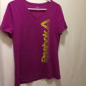 Women's size large purple Reebok  shirt